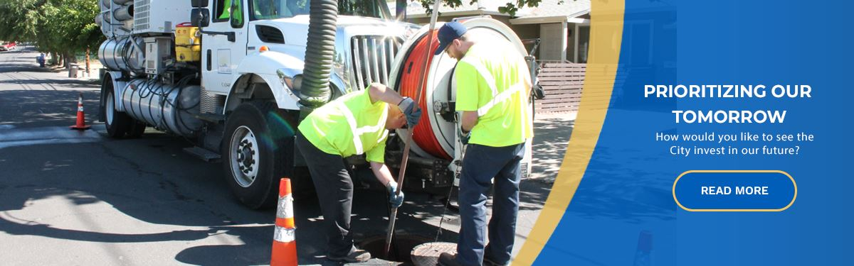Public Works staff cleaning a sewer line