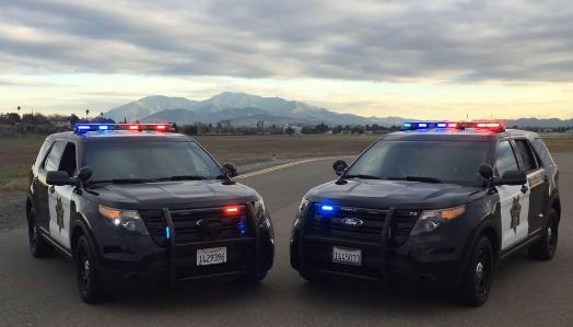 Police cars in front of Mt. Diablo